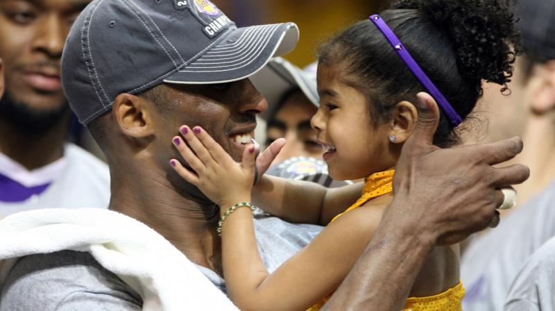 Los Angeles Lakers guard Kobe Bryant with his daughter Gianna. AP Photo