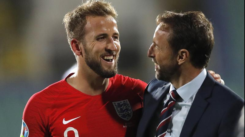 Harry Kane shares a moment with England manager Gareth Southgate. AP Photo