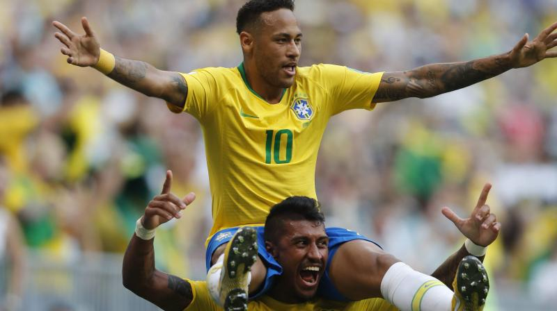 Brazil's Paulinho carries teammate and goal-scorer Neymar on his shoulders. AP Photo