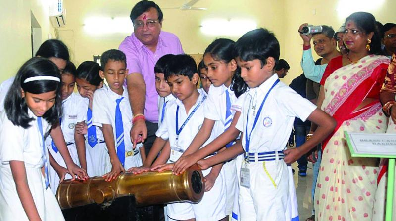 Students look at an old brass canon during the inauguration of Cossipore Gun And Shell Museum in Kolkata on Friday. Established in 1801, this is claimed to be the oldest factory in South East Asia.  (Photo: Abhijit Mukherjee)