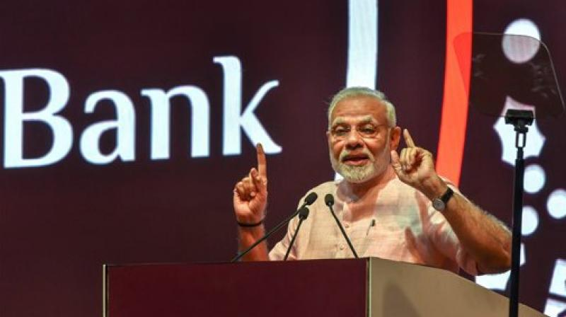 Prime Minister Narendra Modi launched a payments bank on Saturday to turn postmen into bankers so they can offer financial services to the poor in rural areas and boost digital transactions. (Photo: PTI)
