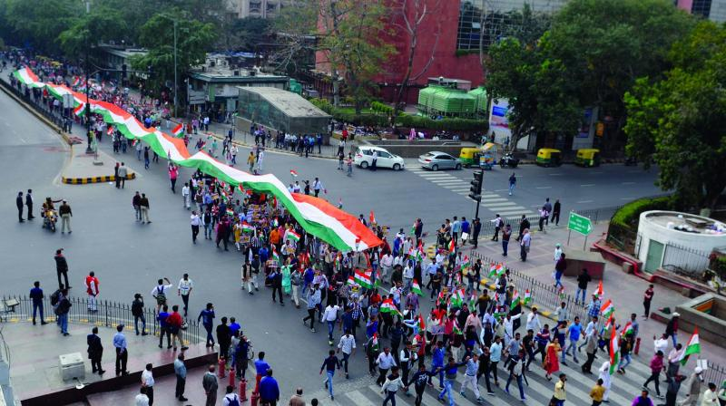 People carry a tricolour during a peace march to protest against communal violence in northeast Delhi on Saturday. (Photo: Biplab Banerjee)
