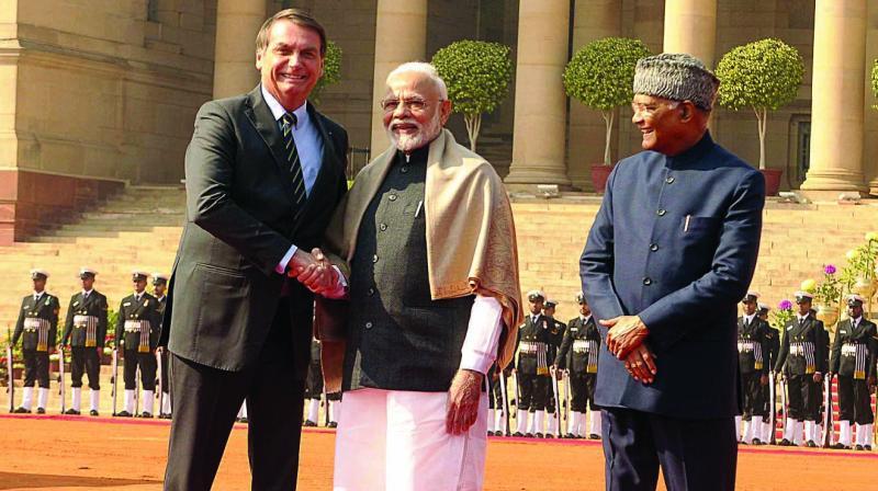Brazilian President Jair Bolsonaro with Prime Minister Narendra Modi and President Ram Nath Kovind in New Delhi on Saturday. (Photo: Pritam Bandyopadhyay)