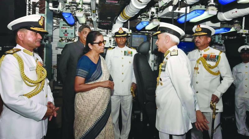 Union minister for defence Nirmala Sitharaman interacts with Chief of Naval Staff Admiral Sunil Lanba at the commissioning ceremony of INS Kiltan into the Indian Navy at naval dockyard in Visakhapatnam. (Photo: PTI)