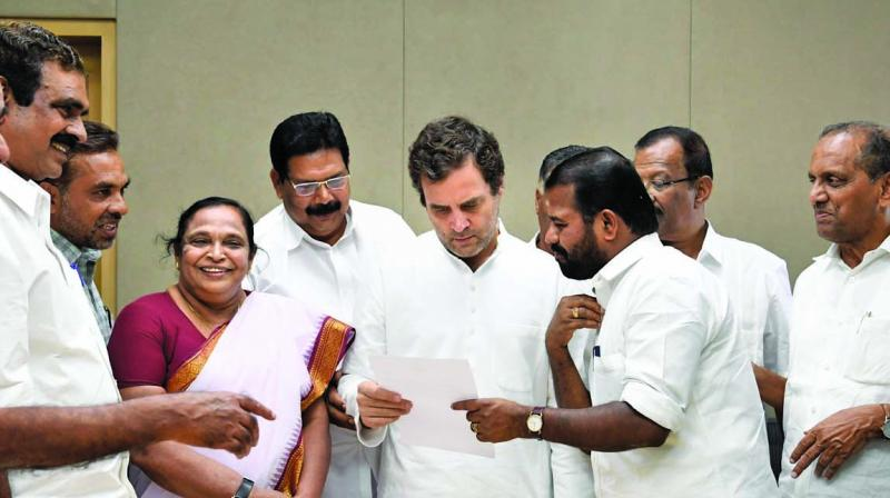 Congress president Rahul Gandhi with leaders and representatives from his Parliamentary constituency Wayanad, in New Delhi on Friday. (Photo: PTI)