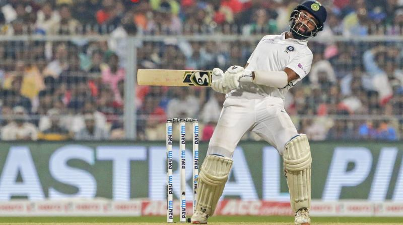Chatashwar Pujara avoids a rising delivery on a day of dour batting. AP Photo
