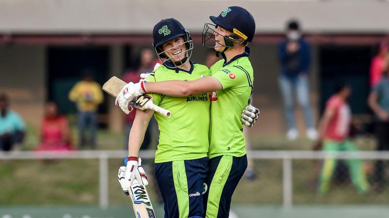 Ireland's Kevin O'Brien (L) and teammate Harry Tector celebrate after winning the third T20 against Afghanistan in Greater Noida on Tuesday. AFP Photo