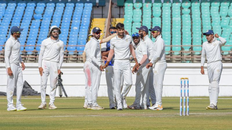 Saurashtra bowler Chirag Jani celebrates after taking the wicket of Manoj Tiwary during the third day's play of the Ranji Trophy final in Rajkot on Wednesday. PTI Photo