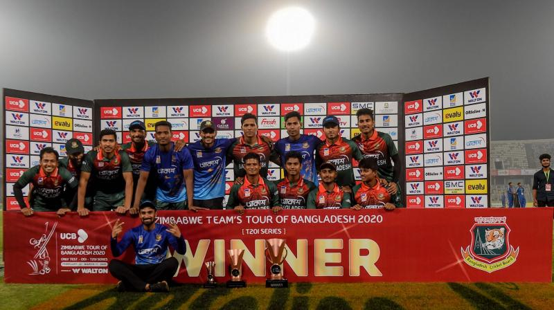 Bangladesh players pose with the trophy after winning the Twenty20 international series against Zimbabwe 2-0 at the Sher-e-Bangla National Cricket Stadium in Dhaka on March Wednesday. AFP Photo