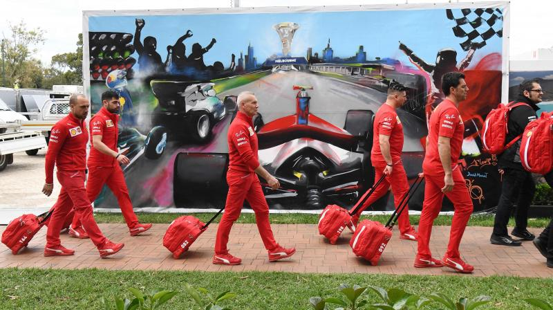 Members of the Ferrari team return from the pit to pack up their equipment after the Formula One Australian Grand Prix was cancelled in Melbourne on Friday, just hours before the action was due to start. AFP Photo