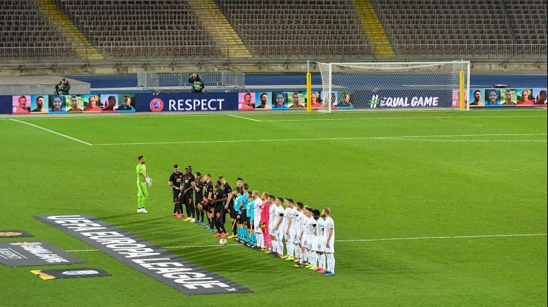 Players of Lask and Manchester United line up prior to the UEFA Europa League last 16, first leg match behind closed doors in Linz, Austria, on Thursday. AFP Photo