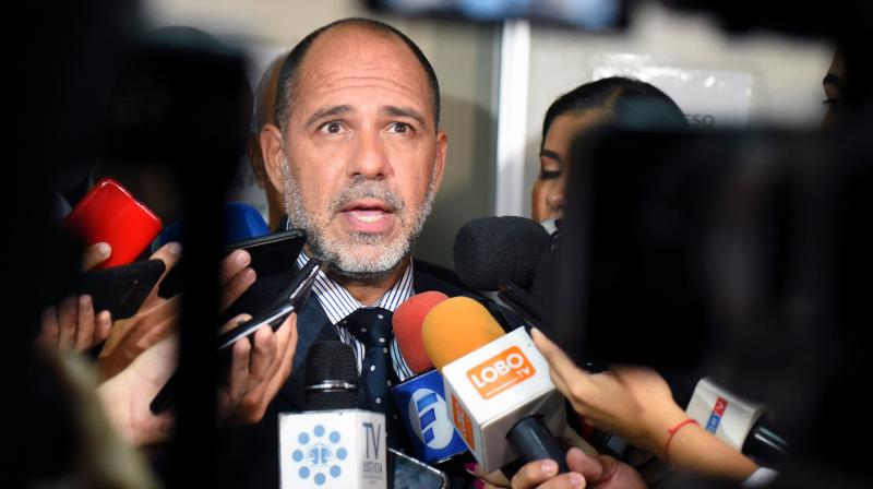 Paraguayan judge Gustavo Amarilla speaks with the press after ratifying Brazilian retired football player Ronaldinho and his brother Roberto Assis' pretrial detention, for allegedly entering Paraguay with a fake passport, at the Justice Palace in Asuncion on Tuesday. 10, 2020. AFP Photo