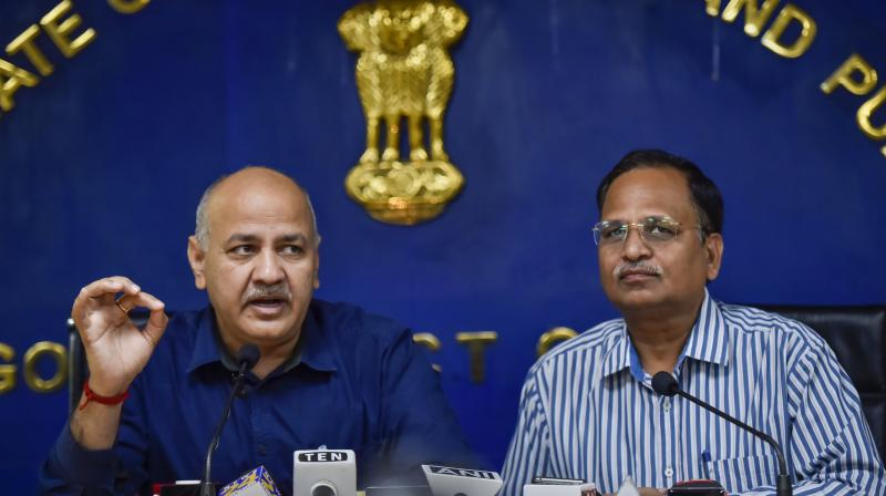 Delhi deputy chief minister Manish Sisodia announces his government's decision to ban IPL games in the national capital at a press conference held along with Health Minister Satyendra Jain (R) in New Delhi on Friday. PTI Photo