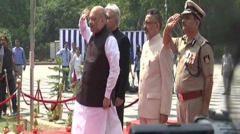 Union Home Minister Amit Shah on Sunday visited the National Police Memorial to pay tribute to the policemen who sacrificed their lives in the line of duty. (Photo: ANI)