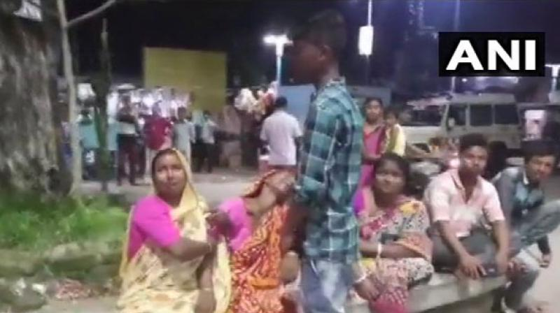 Relatives mourning the killing of TMC leader in Cooch Behar, West Bengal. (Photo: ANI)