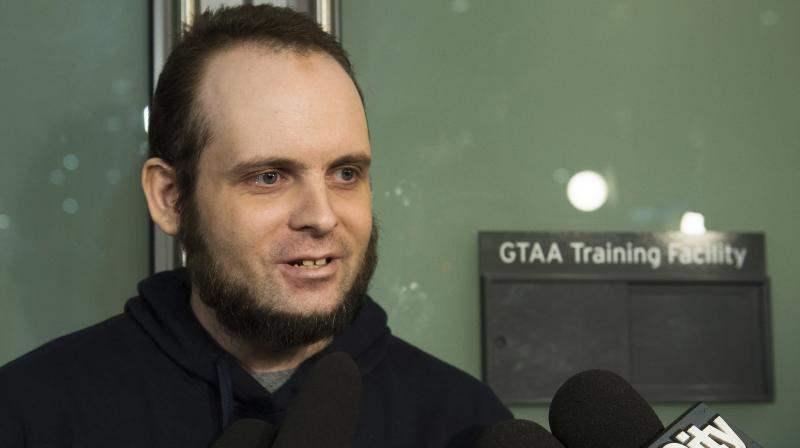 Joshua Boyle speaks to the media after arriving at the Pearson International Airport in Toronto. (Photo: AP)