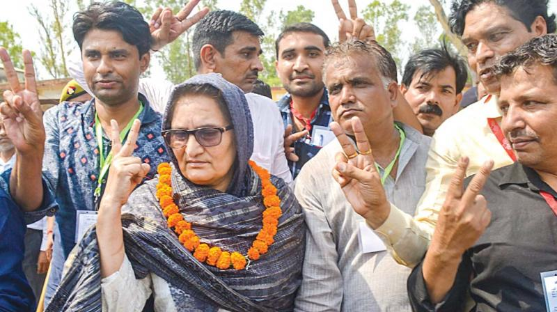 RLD candidate Tabassum Hasan with her supporters after winning the Kairana Lok Sabha byelections. (Photo: PTI)
