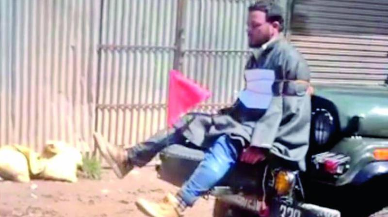 A man, tied to a moving Army jeep, allegedly being used as a human shield against stone-pelters during Srinagar bypolls.