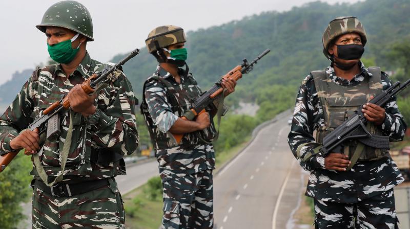 Central Reserve Police Force (CRPF) jawan keep a watch on the Jammu-Srinagar National Highway near Jammu. (PTI)