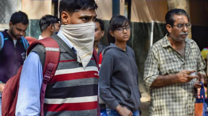 A man uses a handkerchief to cover his face in the wake of novel coronavirus or COVID-19 outbreak at a hospital. (Photo- PTI)