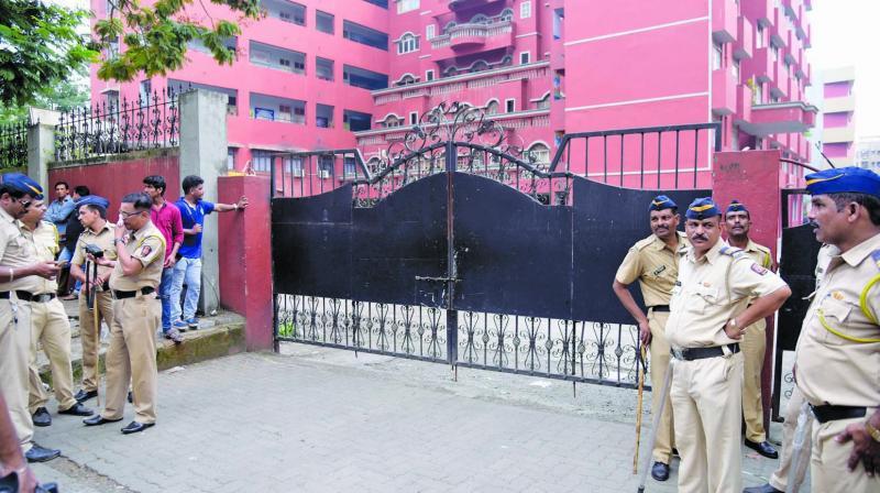 Police and media outside Ryan school, Kandivali.