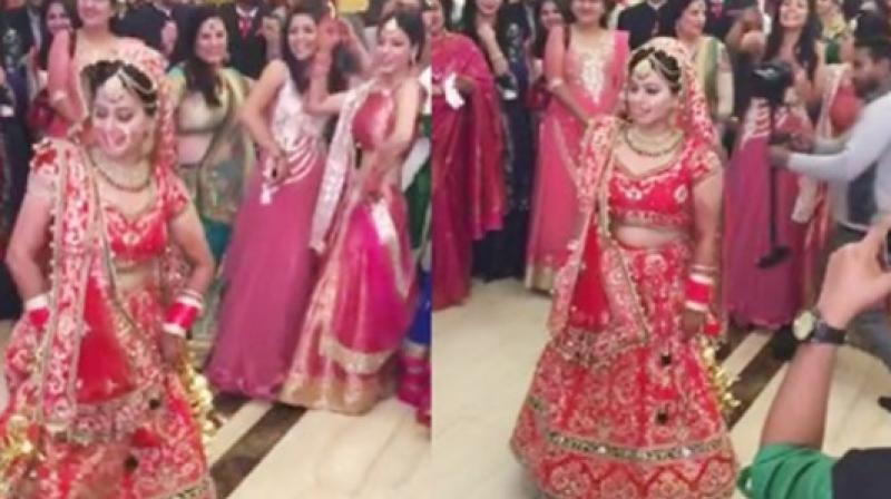 This lovely bride won hearts across the Internet when she showed off some seriously sassy moves before taking part in the marriage rituals. (Credit: Facebook)