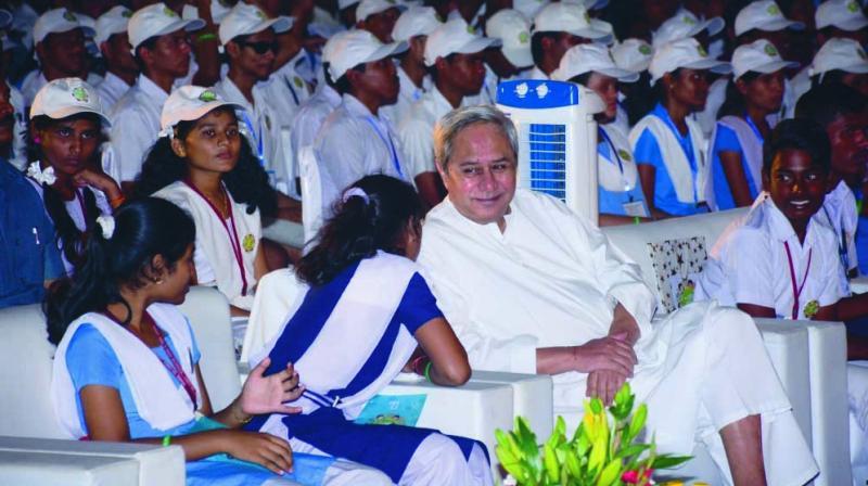 Odisha chief minister Naveen Patnaik interacting with school students in Bhubaneswar.