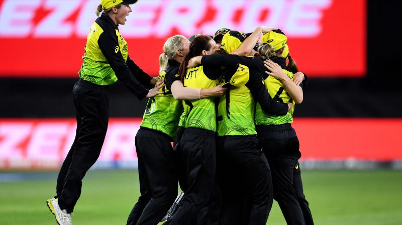 Australian players celebrate after a victory against India in the Twenty20 womens World Cup cricket final match on March 8, 2020(AFP)