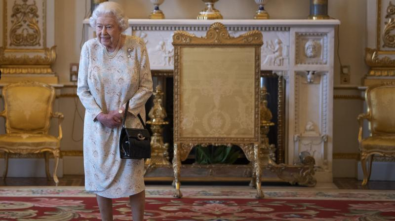 According to People magazine, before the queen puts on any pair of shoes, her dressmaker and close confidant, Angela Kelly, break them in herself. (Photo: AP)