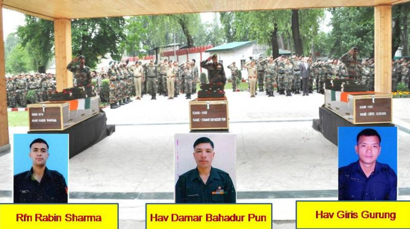 15 Corps Commander Lt Gen JS Sandhu paying tributes to Rifleman Rabin Sharma, Havaldar Damar Bahadur Pun and Havaldar Giris Gurung, at a wreath laying ceremony at 15 Corps headquarters in Srinagar. (Photo: PTI)