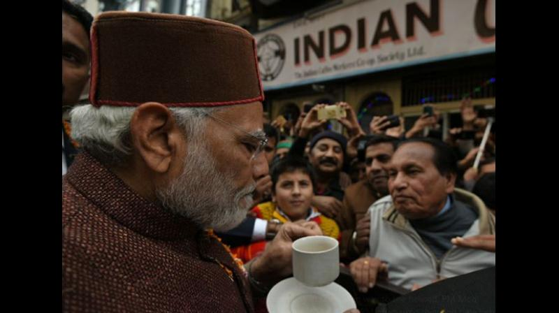 The Prime Minister stopped for a hot cup of coffee at the iconic Indian Coffee House while on the way to the helipad after attending the ceremony of Himachal Pradesh's new cabinet. (Photo: ANI)