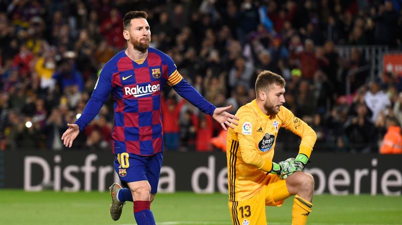 Barcelona star Lionel Messi on Sunday scored his 34th hat-trick in La Liga which helped his club register a win against Celta Vigo.  With this, Messi equalled the record of Juventus' Cristiano Ronaldo as the former Real Madrid player has the same number to hat-tricks under his belt. (Photo:AFP)