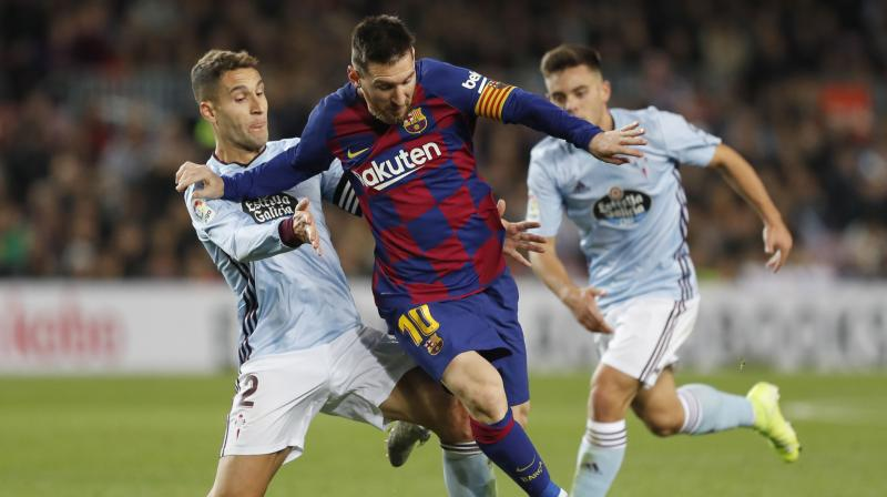 Lionel Messi delivered an incredible dead-ball hat-trick to steer Barcelona to a 4-1 victory over Celta Vigo and ease the pressure on his coach Ernesto Valverde. (Photo:AP)
