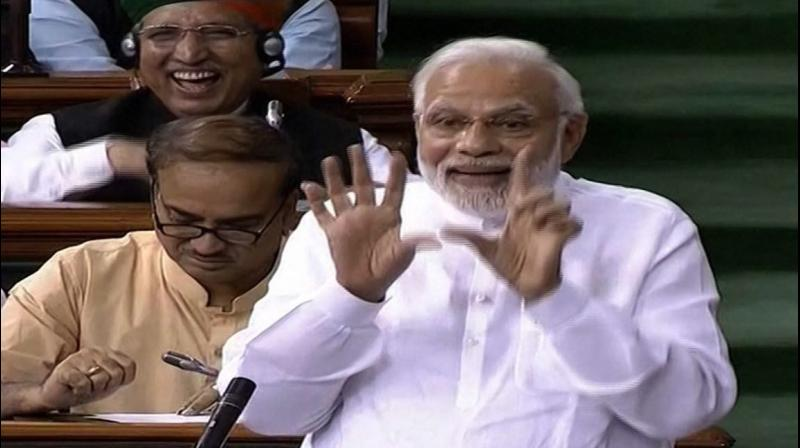 Prime Minister Narendra Modi speaks in the Lok Sabha on 'no-confidence motion' during the Monsoon Session of Parliament, in New Delhi. (Photo: PTI)