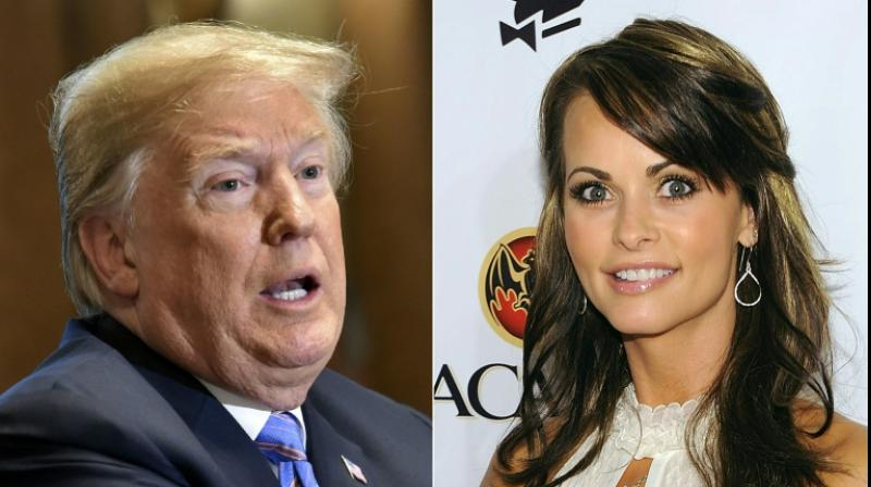 Former Playboy model Karen McDougal claims she had a months-long affair with Trump after they met in 2006, shortly after Trump's wife Melania gave birth to their son Barron. (Photo: AFP)