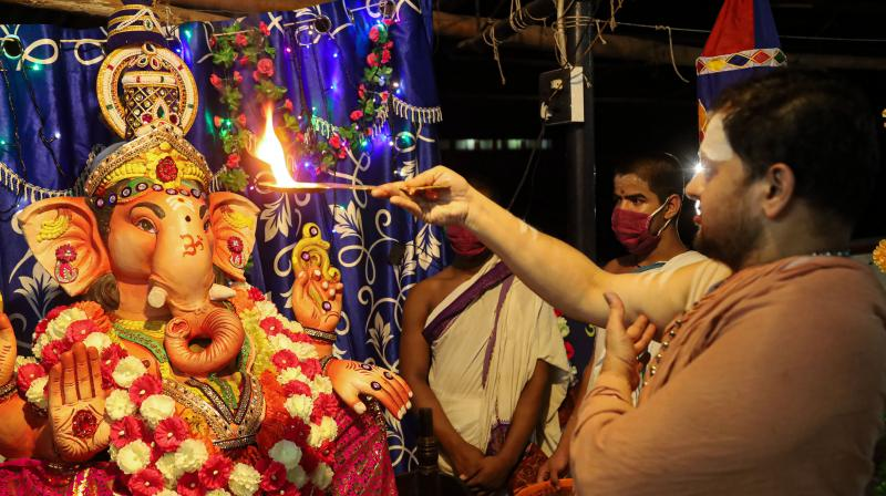 A priest performa aarti to Lord Ganesh. — (PTI representational pic)