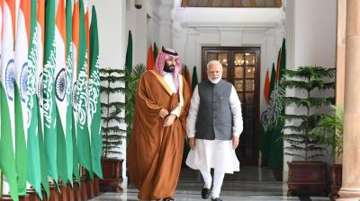 Prime Minister Narendra Modi walks with Saudi Crown Prince Mohammad bin Salman ahead of bilateral talks.(Photo: @MEAIndia | Twitter)