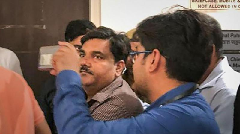 Delhi police personnel take suspended AAP councillor Tahir Hussain into custody after Delhi Court rejected his plea to surrender before it, at Rouse Avenue Court in New Delhi. (PTI photo)