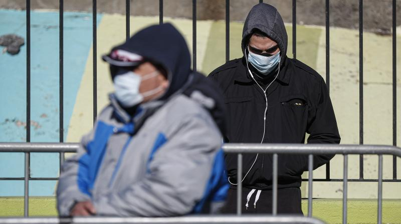 PAtients wearing masks and gloves wait to be directed into Covid19 testing centre in New York. AFP Photo