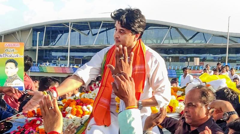 BJP leader Jyotiraditya Scindia being welcomed by his supporters on his arrival at Bhopal Airport on March 12, 2020. (PTI)