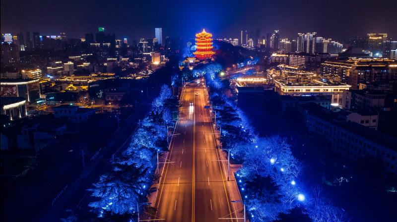 This aerial photo taken on March 16, 2020 shows a view of an empty road at night in Wuhan in China's central Hubei province. China reported on March 17 just one new domestic coronavirus infection but found 20 more cases imported from abroad. (AFP)