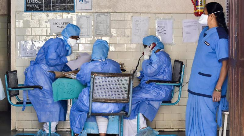 Medics outside an isolation ward of a hospital. The doctor who treated a man who tested positive after his death has also been found positive. (PTI )0060B)