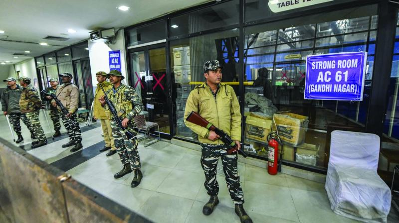 Security personnel stand guard outside the strongroom of a counting centre in Akshardham in New Delhi on Sunday. (Photo: PTI)