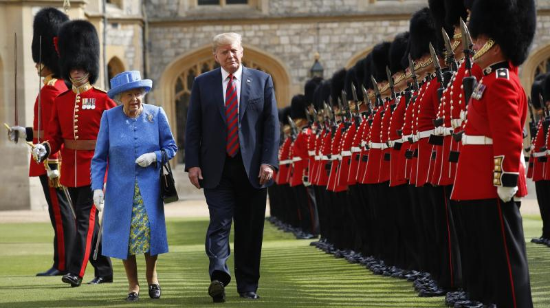 Trump's first visit to Britain as president was not the full state visit he was originally promised, but he was heralded by military bands on his arrival at Windsor. (Photo: AP)