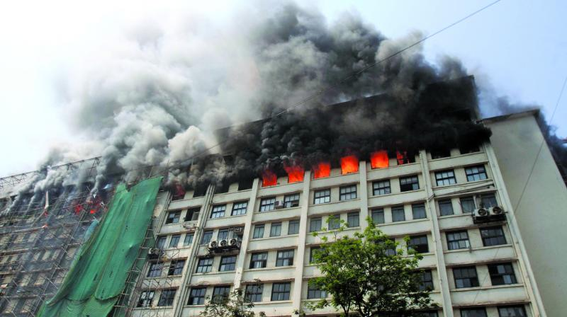 Smoke billows out of the GST Bhavan after a fire broke out on its eighth floor in Mazgaon, Mumbai on Monday. (Photo: Rajesh Jadhav)