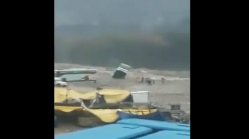 The bus was empty when it was washed away into the flooded Beas River. (Photo: Screengrab   ANI)