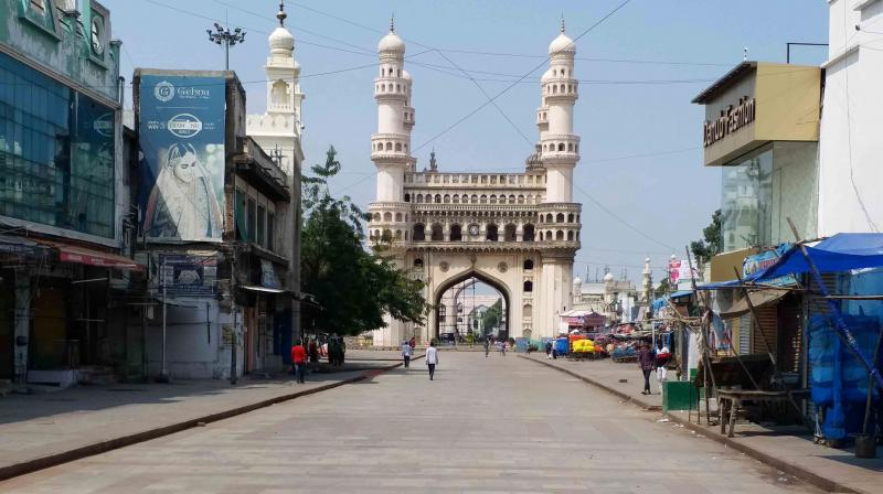 Road leading to the historic Charminar wear as deserted look during the lockdown in wake of coronavirus pandemic, in Hyderabad. PTI Photo