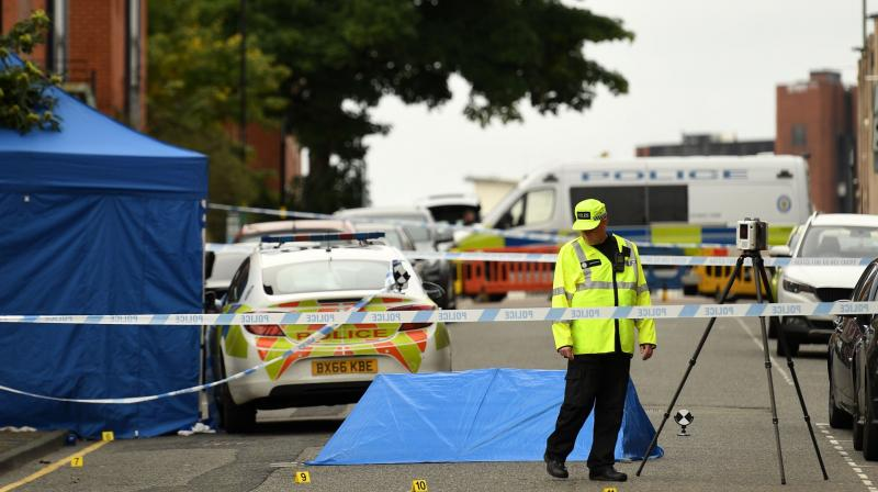 Police gather evidence near to forensics tents and evidence markers inside a cordon on Irving Street, following a major stabbing incident in the centre of Birmingham, central England, on September 6, 2020. - British police declared a