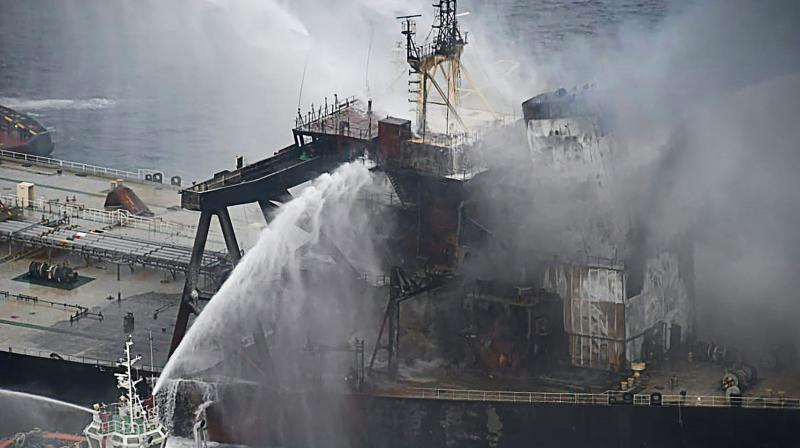 Fireboats battling to extinguish a fire on the Panamanian-registered crude oil tanker New Diamond, some 60 km off Sri Lanka's eastern coast where a fire was reported inside the engine room. - India on September 8 sent fresh supplies of firefighting chemicals to help battle a new blaze on a stricken tanker loaded with a massive cargo of crude oil off Sri Lanka's eastern coast. (AFP)