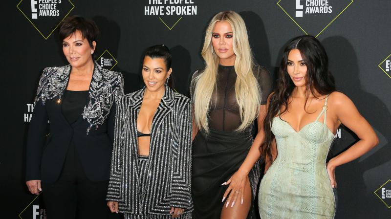 (L-R) Business women/media personality Kris Jenner, Kourtney Kardashian, Khloé Kardashian and Kim Kardashian arrive for the 45th annual E! People's Choice Awards at Barker Hangar in Santa Monica, California. - Fans will have to find another way to keep up with the Kardashians, as the mega-celebrity family announced on September 8, 2020 that their reality show will end next year.